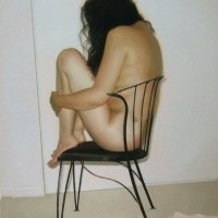 Figure on Chair